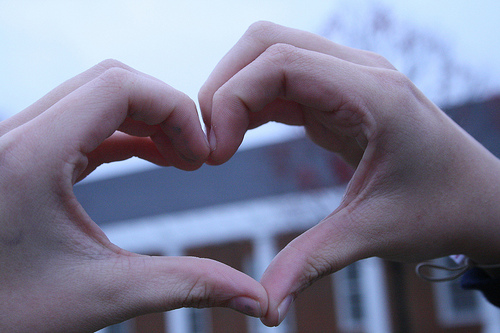 2 hands making the shape of a heart