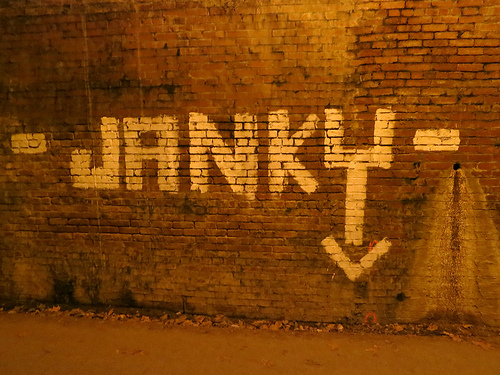 "a brick wall that has ""JANKY"" painted on it"