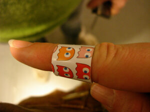 finger with a Pac-Man Band-Aid on it