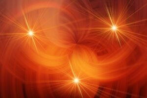 an abstract image of red swirls with 3 starbursts