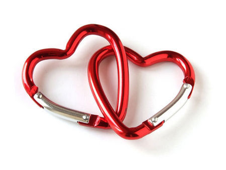 two interlinked heart-shaped carabiners