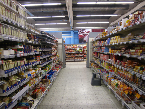 grocery store aisle loaded with goods