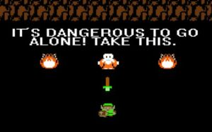 """screenshot from Legend of Zelda, which reads """"It's Dangerous to Go Alone! Take This."""""""