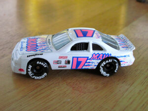 a small white and pink toy car