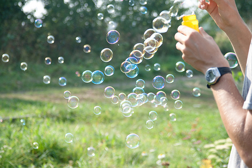a person blowing bubbles