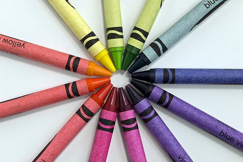 color wheel made up of crayons of various colors