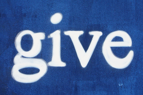 "painting of the word ""give"" in white letters on a blue background"