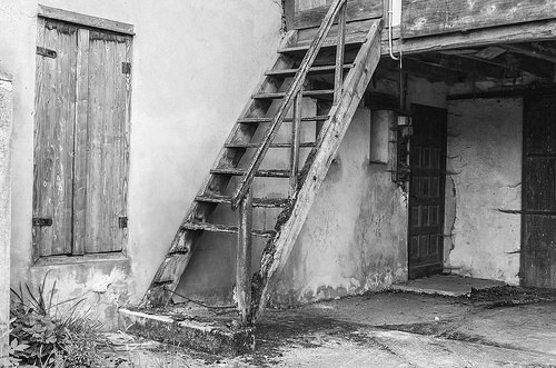 an antique staircase with a missing stair