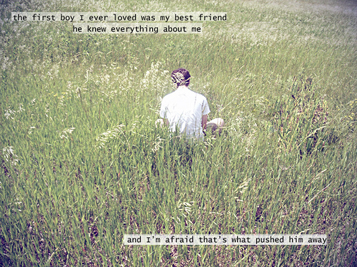 "a photo of a person in a white shirt viewed from the back, they are sitting in a field of grass, text over picture reads ""the first boy I ever loved was my best friend and I'm afraid that's what pushed him away"""