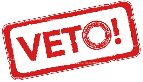 "red rubber stamp mark that reads ""veto"""