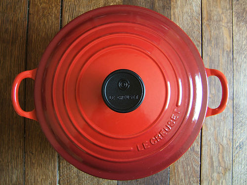 a red casserole pan with lid, viewed from above