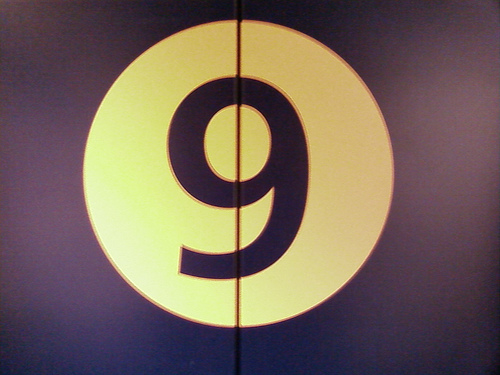 the number 9 in the style of an old-time movie reel countdown to a motion picure