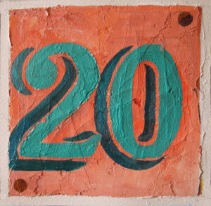 the number 20 painted in teal on a salmon background
