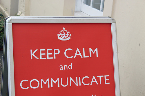 "a sign that has a crown at the top. It reads ""Keep calm and communicate"""