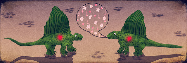 2 cartoon dinosaurs (looks like dimetrodon) hanging out, the one on the left has a speech balloon full of pink flowers