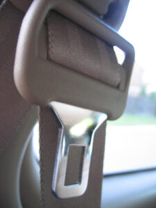 a seatbelt in a car, in its default not-in-use position