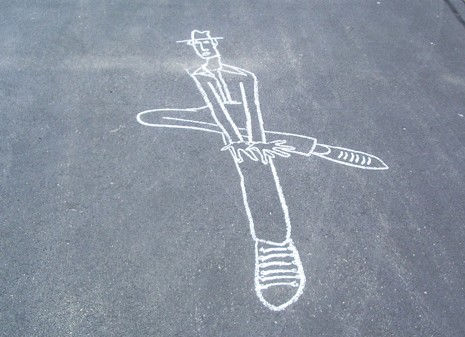 a sidewalk chalk image of a person wearing a hat. the person has their legs crossed