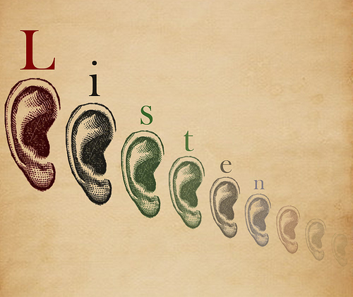 "a series of listening ears arranged from left to right in order of largest to smallest, over the top of the ears is the word ""Listen"""