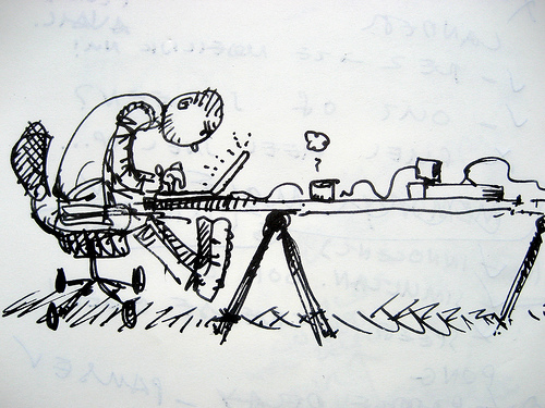 a drawing of a cluttered desk. A stick figure person is bent over a laptop at an uncomfortable angle. The ergonomics are terrible.