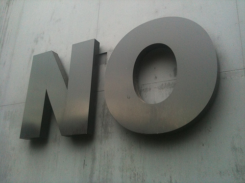 "a big sign on a wall that reads ""NO"""