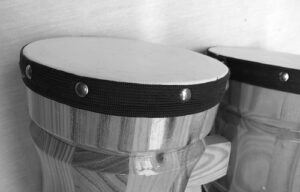 a black and white picture of 2 bongos, shot fairly close up
