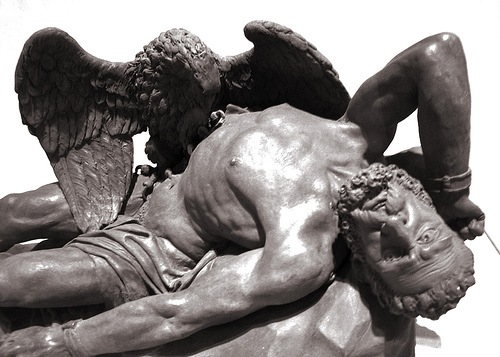 statue of Prometheus, the mythological figure, as he's lying back having his liver eaten out by an eagle