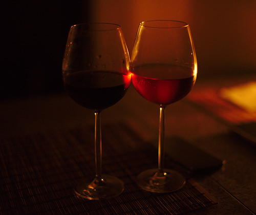 2 glasses of red wine on a table