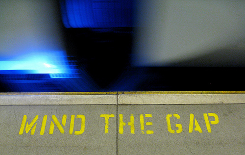 A London subway platform. It reads Mind the Gap.