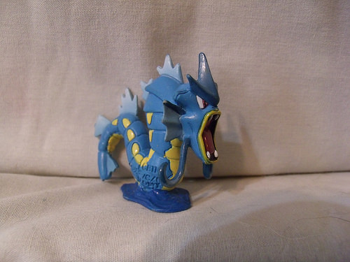A plastic toy of the Pokemon gyarados, who is a blue water dragon sea monster-type creature