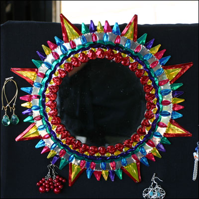 a multicolored mirror shaped like the sun