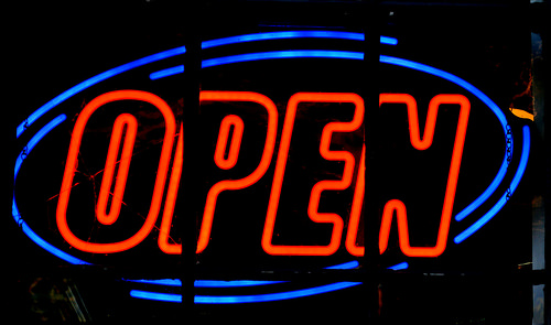 a neon sign that reads open