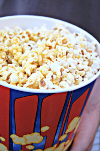 a bucket of movie theater popcorn
