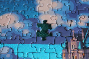 a closeup of a jigsaw puzzle that is missing a single piece