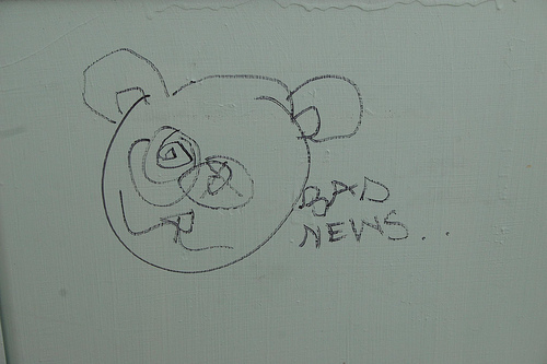 "a child's drawing of a bear with the words ""BAD NEWS..."" written next to it"