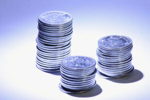 3 stacks of silver coins, of varying heights