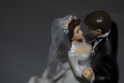 a closeup of a bride and groom cake topper