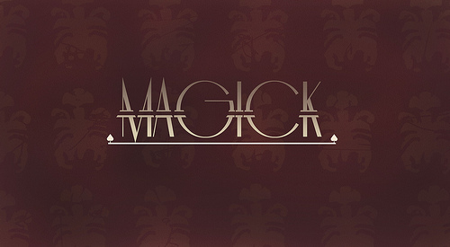 "a burgundy background with what seem to be fleur-de-lis watermarks. It reads ""MAGICK"" in a fancy script in silver metallic letters"