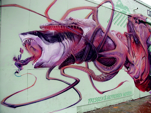 a mural of a lawyer being eaten by a shark being eaten by a mosasaur being eaten by a giant squid being eaten by a large pirranha being eaten by a demon