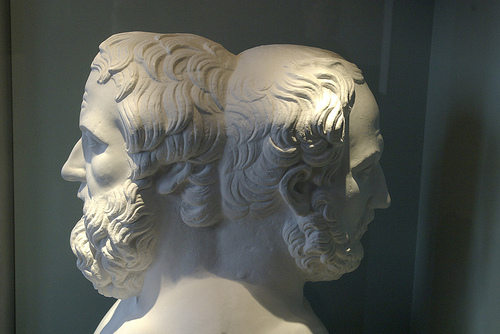 a statue of Janus, a bearded man with two faces, one facing forward and one looking back