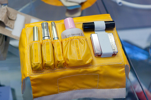 a makeup kit in a yellow holder. According to the photographer's page, this is a makeup kit for a female Space Shuttle astronaut