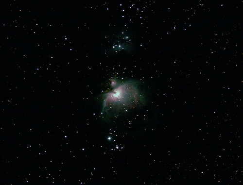 a starry night sky with the Orion nebula featured in the center