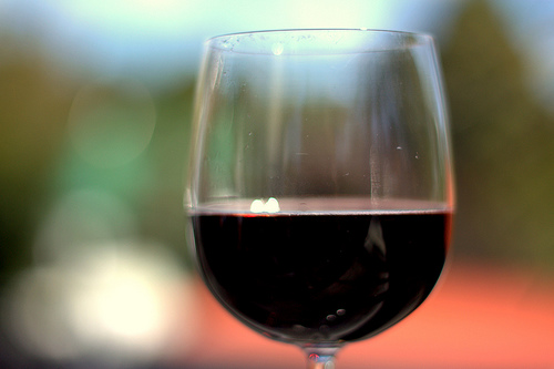 a closeup photo of red wine in a glass
