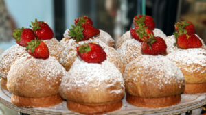 muffins topped with powdered sugar and strawberries