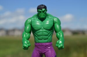 it's a toy figure of the Incredible Hulk, a shirtless green body builder type guy in purple shorts