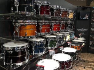 a large array of tom-tom drums in various colors