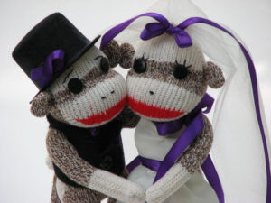 bride and groom wedding cake toppers made of sock monkey puppets