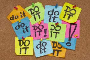 """a board of multicolored post-it notes that all say """"do it!"""" in marker"""