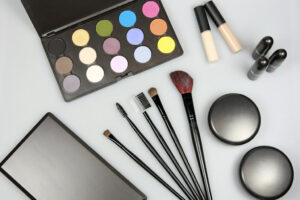 a set of makeup including a brush set, an eyeshadow palette, a couple of compacts, and a few containers of foundation