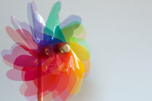 a rainbow colored pinwheel photographed while it's spinning