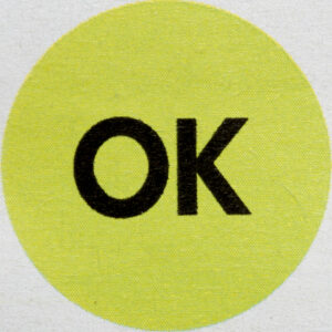 """a yellow circle with black letters inside that say """"ok"""""""